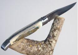 Couteau Laguiole avec lame Damas Inox et son manche en Croute d'Ivoire Fossile de Mammouth