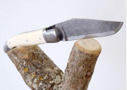 Couteau Laguiole avec lame Damas forgée artisanale et son manche en Ivoire Fossile de Mammouth