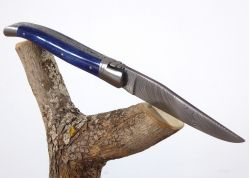 Laguiole Knife with Damascus Inox Blade with its Giraffe's Bone Colored Handle.